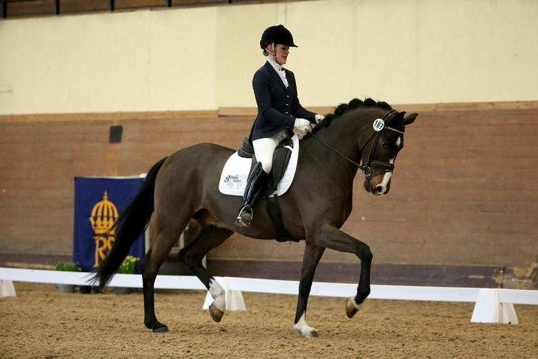 Strömsholm 140327 Dressyr Emelie Nyreröd och Floppy Disc vann dressyrklassen för 5-åriga hästar. Photo: Roland Thunholm Code:718 35