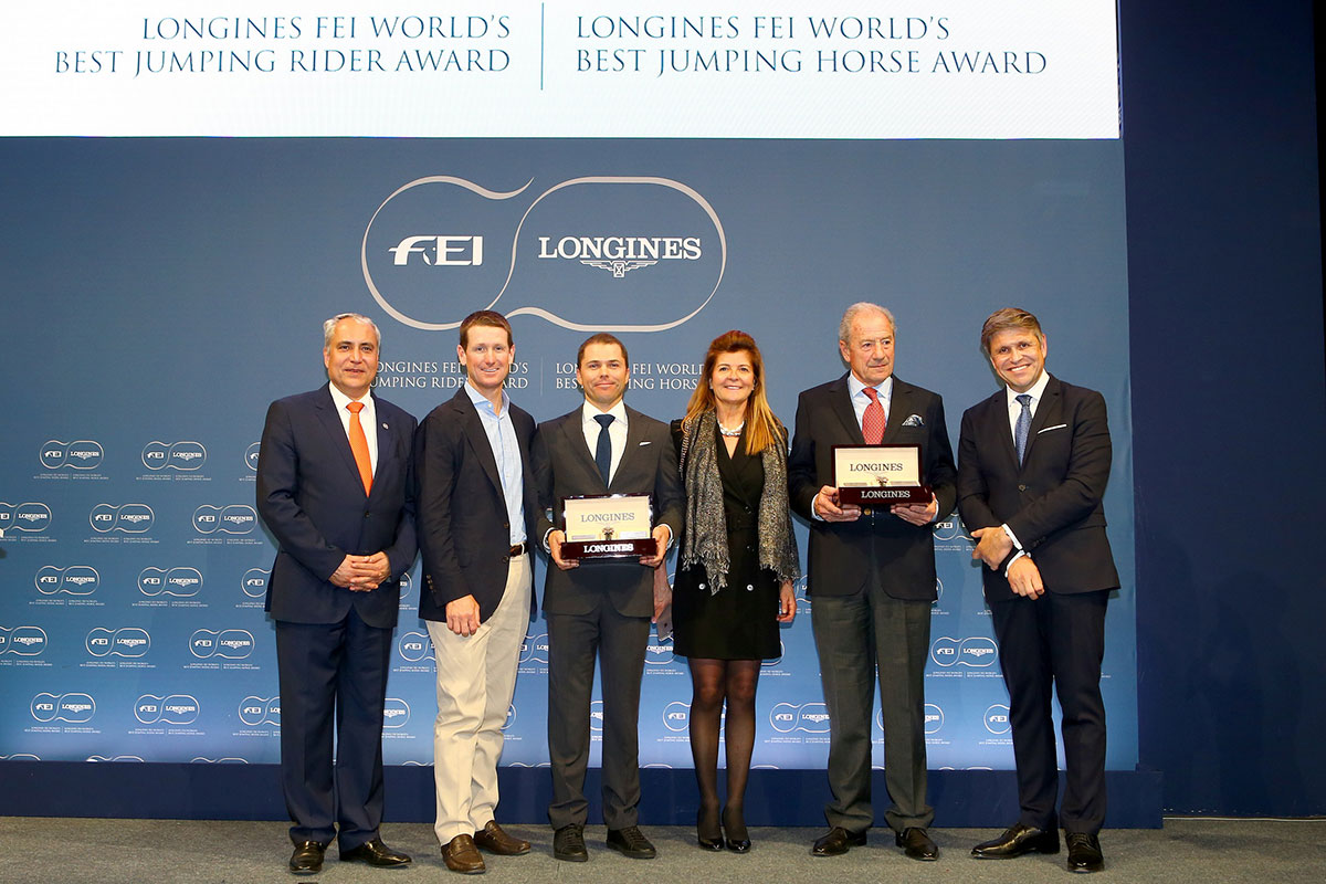The Longines FEI awards for best jumping rider and best horse presented tonight at the Paris City Hall. From left to right : FEI President Ingmar De Vos, McLain Ward (USA), Kent Farrington (USA) winner of the Longines FEI Best Rider Award, Claudia Mathy, François Mathy and Juan-Carlos Capelli, Vice President of Longines and Head of International Marketing (Longines/Pierre Costabadie)