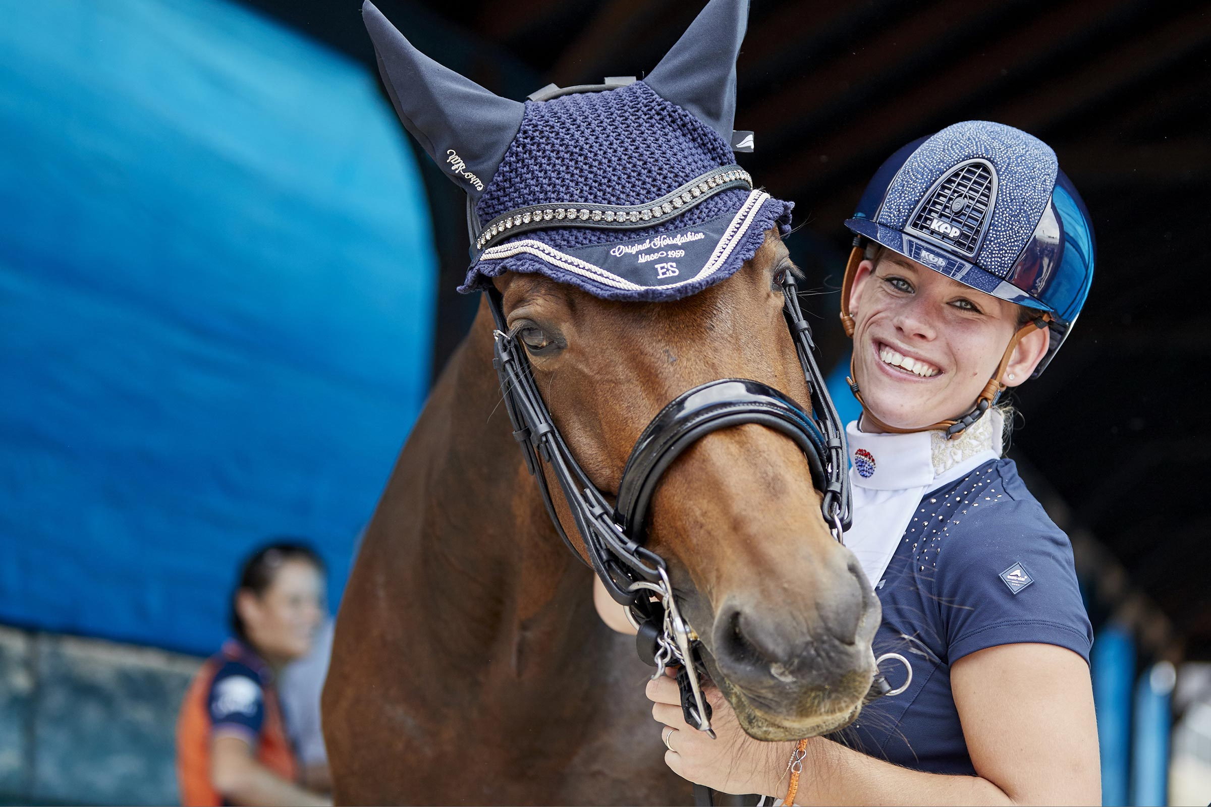Rixt Van der Horst (NED) with her new horse, Findsley take delight in securing the gold medal in the Adequan© Para Dressage at the FEI World Equestrian Games™ Tryon today, successfully defending her World Championship individual title from Normandy 2014. (FEI / Liz Gregg)