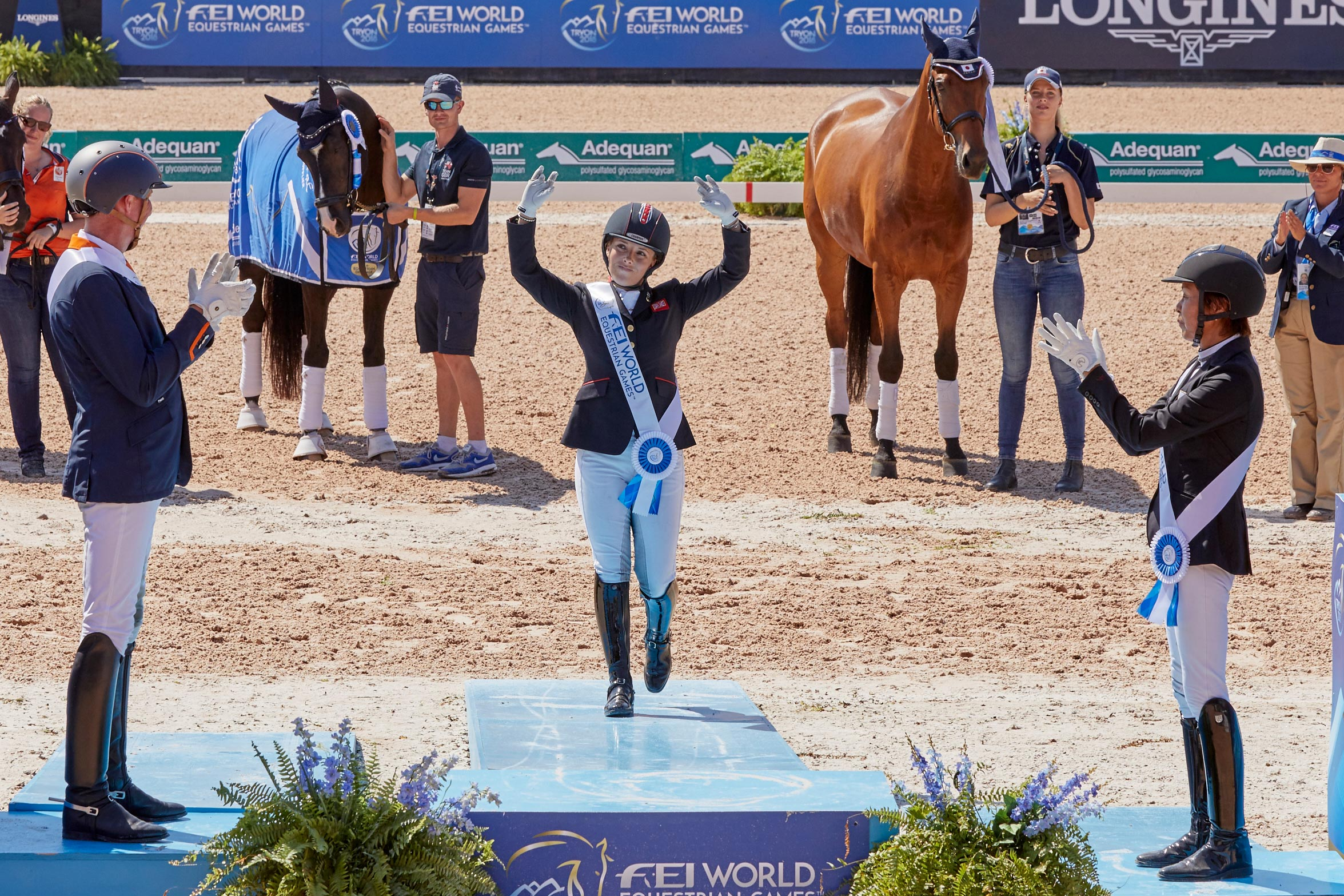 FEI World Equestrian Games™ Tryon USA Gold Medalist takes to the podium Sophie Wells GBR,Silver to Frank Hosmar NL and Bronze to Tomoko Nakamura JP Photo FEI/Liz Gregg